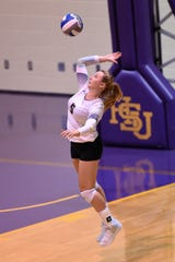 Hardin-Simmons setter Ashley Pierce (5) serves during the Cowgirls conference opener last season.