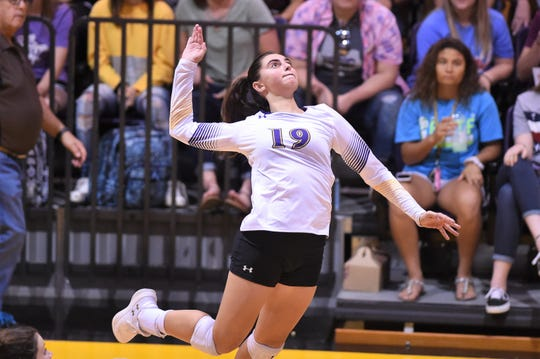 Hardin-Simmons outside hitter Allison Kuster (19) lines up a shot during the ASC opener on Tuesday, Sept. 11, 2018. The Cowgirls fell 3-0.