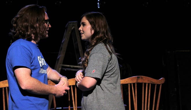 """Neighbors George (Wade Byington) and Emily (Shelby Walker) draw closer, literally, in this rehearsal scene from """"Our Town,"""" which opens a two-weekend run Sept. 21 at the Paramount Theatre."""
