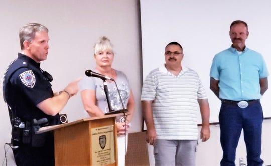 Abilene Police Chief Stan Standridge recognizes three citizens, from left, Dawn Hester, Larry Zientek and Jess Anderson, for preventing a crime and helping police arrest a man.