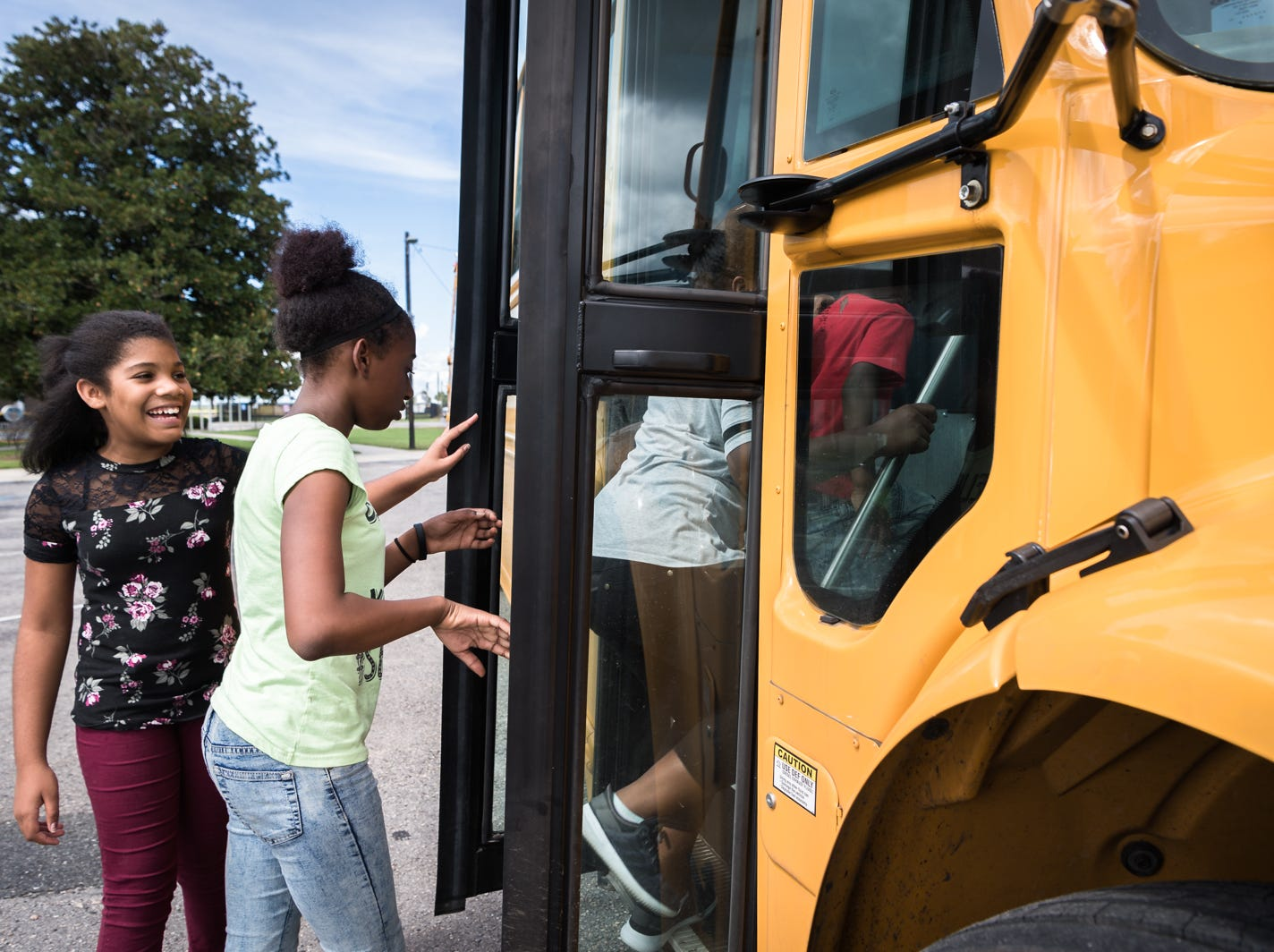 Children board a bus leaving for Knightdale high school in Knightdale, a suburb of Raleigh before Hurricane Florence makes landfall, Sept. 12, 2018. A storm surge of about three to six feet is expected for Swan Quarter, and around six feet for Ocracoke Island with 12-20 inches of rainfall for the entire area. Hyde county as well as several surrounding counties are under mandatory evacuation.