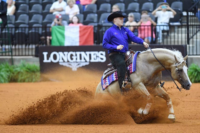 Cade McCutcheon, with his horse, Custom Made Gun, competes in the reining competition Wednesday during the FEI World Equestrian Games at Tryon International Equestrian Center. McCutcheon, 18, is the youngest United States athlete in the games.
