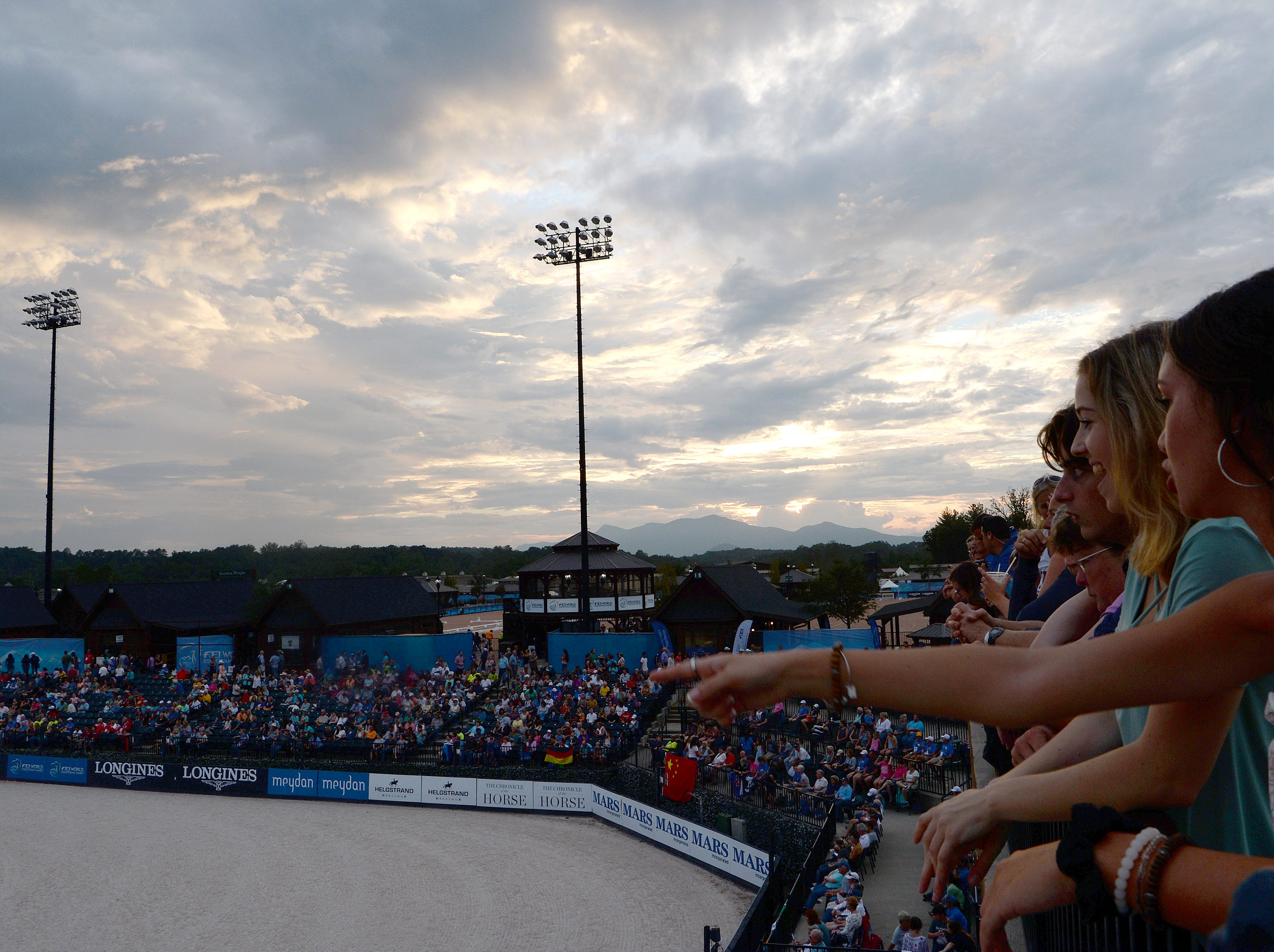 Fans, athletes and volunteers enjoy a concert by artist Hunter Hayes during the opening ceremony for the FEI World Equestrian Games at the Tryon International Equestrian Center on Sept. 11, 2018.