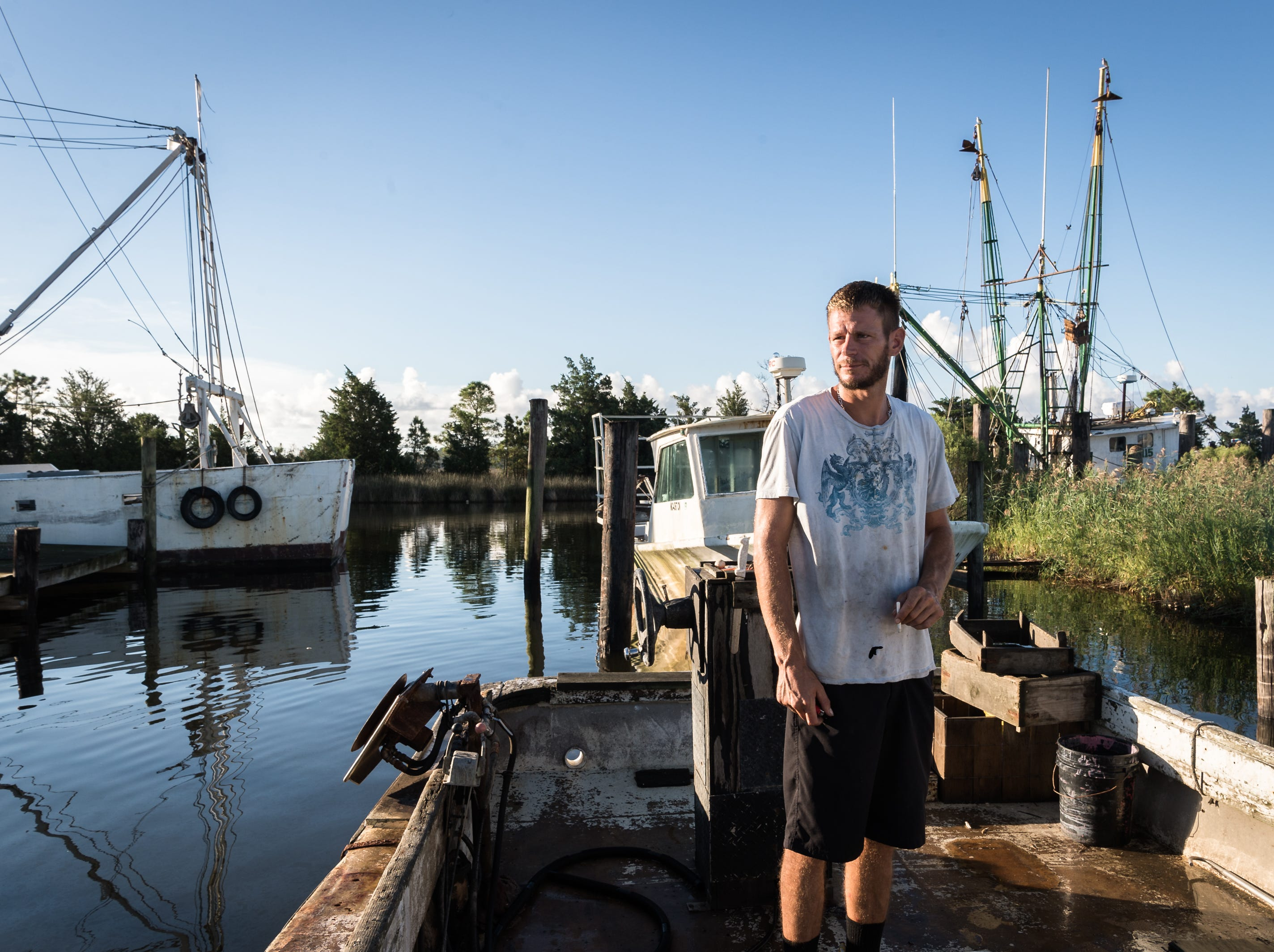 Dane Evans, a fisherman, 36, of Swan Quarter, works on his 31-year-old fishing boat, Captain Drew, named after his six-year-old son, in the Swan Quarter harbor Sept. 12, 2018. As Hurricane Florence moves in, a storm surge of about three to six feet is expected for Swan Quarter, and around six feet for Ocracoke Island with 12-20 inches of rainfall for the entire area. Hyde county as well as several surrounding counties are under mandatory evacuation. Evans will be traveling to Washington, NC to stay with his girlfriend during the hurricane.