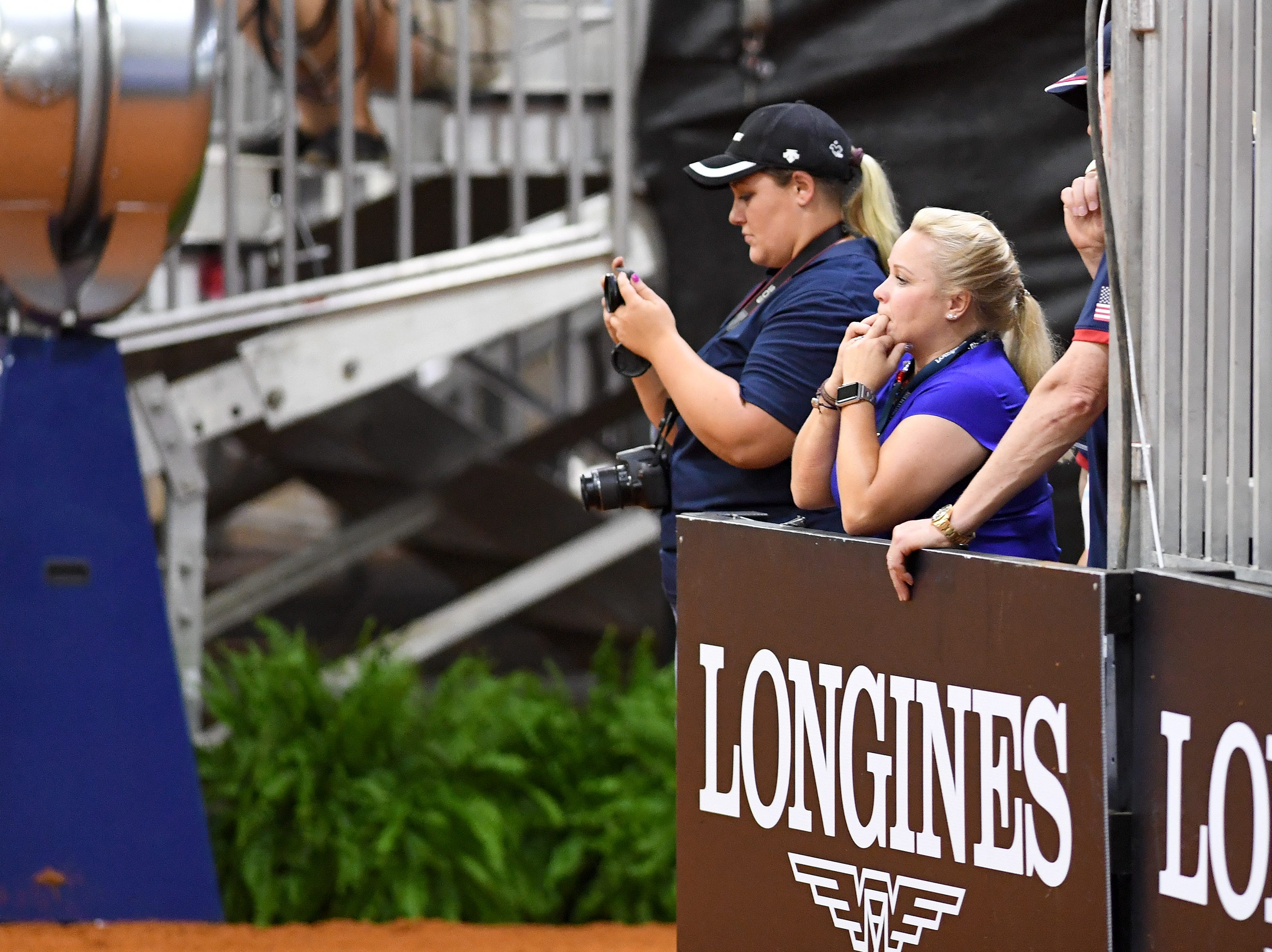 Cade Mccutcheon's mother, Mandy, cheers during the reining competition of the FEI World Equestrian Games at the Tryon International Equestrian Center on Sept. 12, 2018. Mccutcheon is the youngest U.S. competitor in the games and his performance put him in the lead for the first bout of competition.