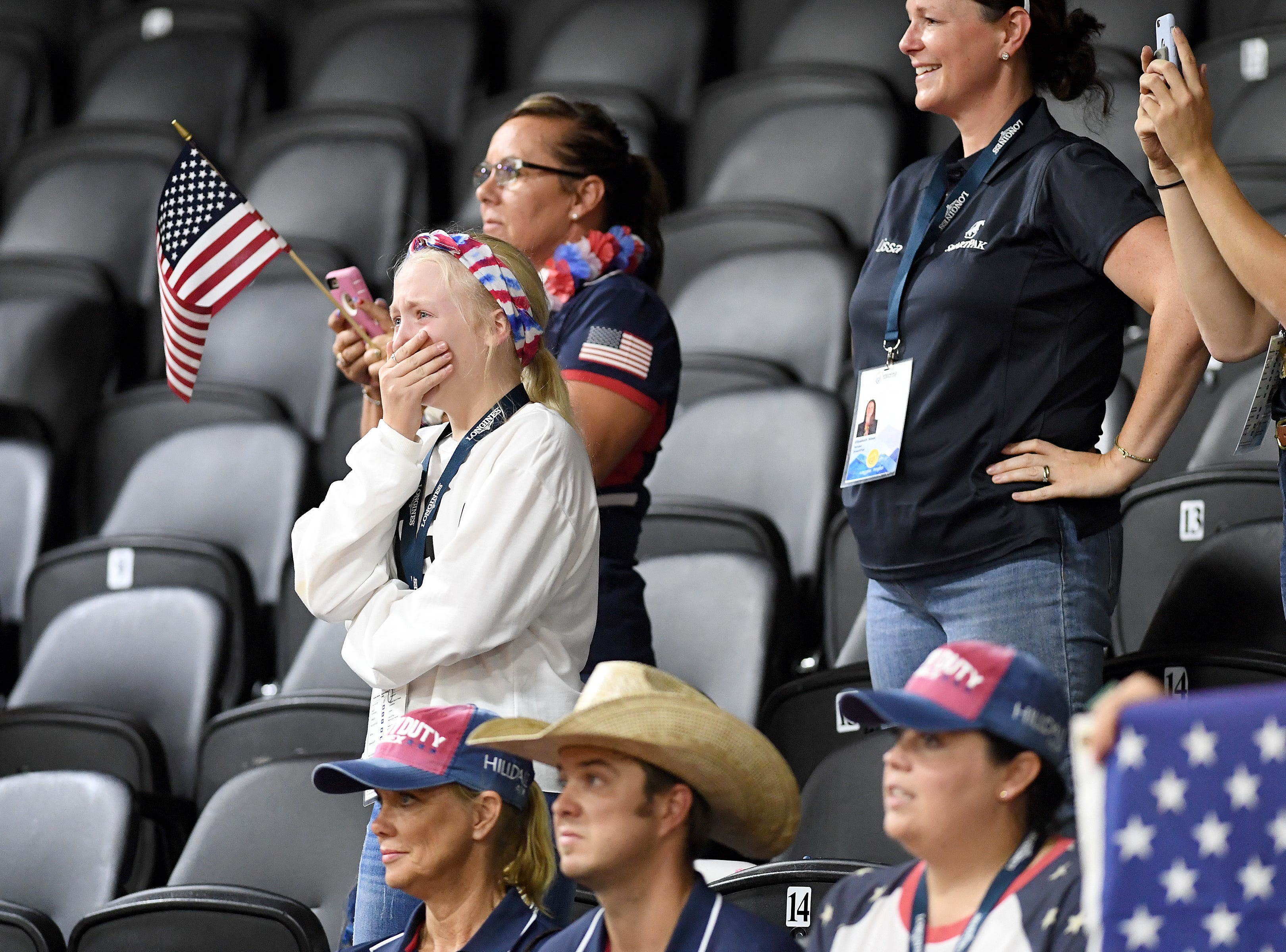 Cade Mccutcheon's little sister, Carlee, 12, both of Texas, is overcome with emotion as he competes during the reining competition of the FEI World Equestrian Games at the Tryon International Equestrian Center on Sept. 12, 2018. Mccutcheon is the youngest U.S. competitor in the games and his performance put him in the lead for the first bout of competition.