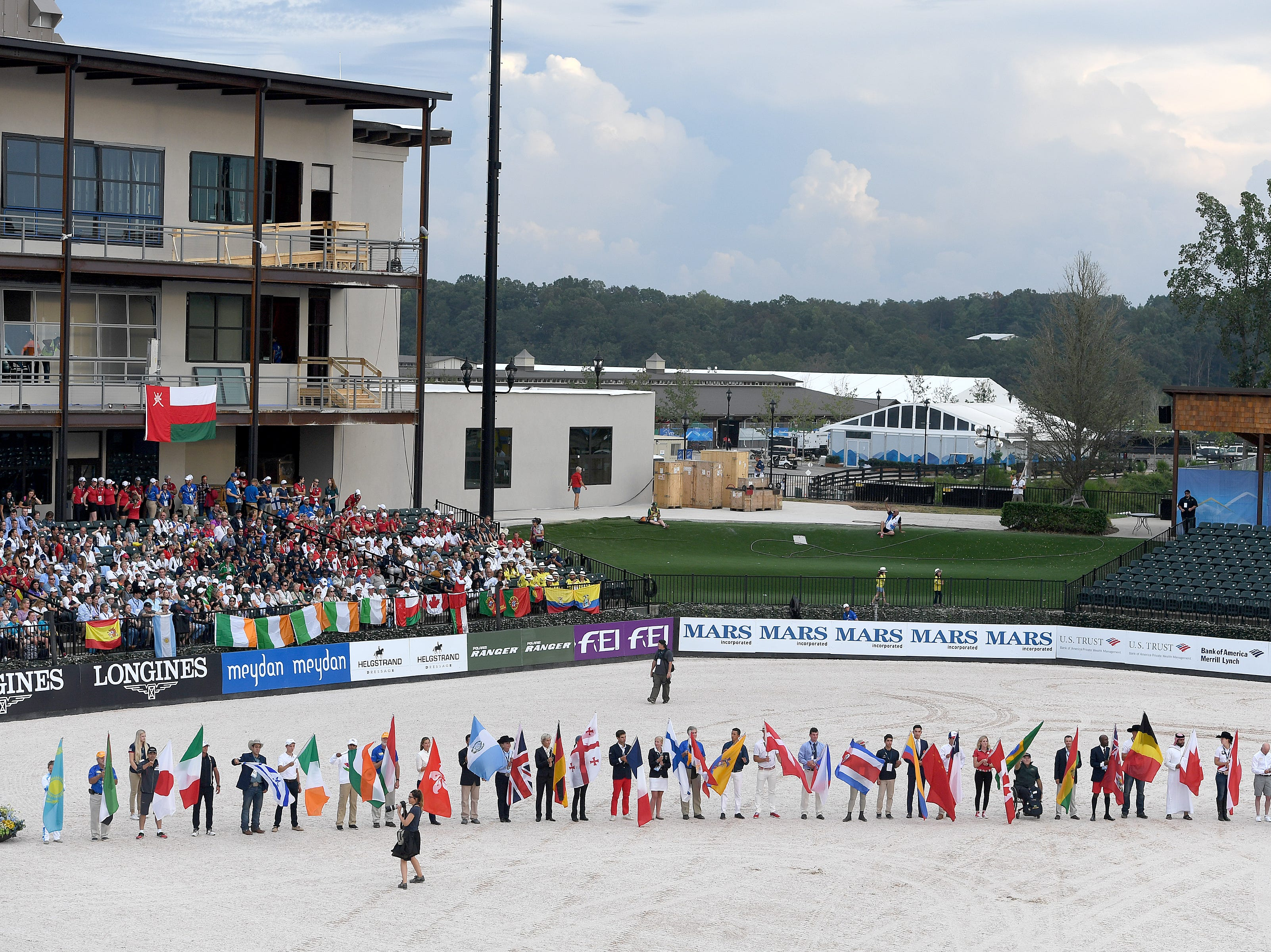 Athletes carried their country's flag in a parade of nations during the opening ceremony for the FEI World Equestrian Games at the Tryon International Equestrian Center on Sept. 11, 2018.