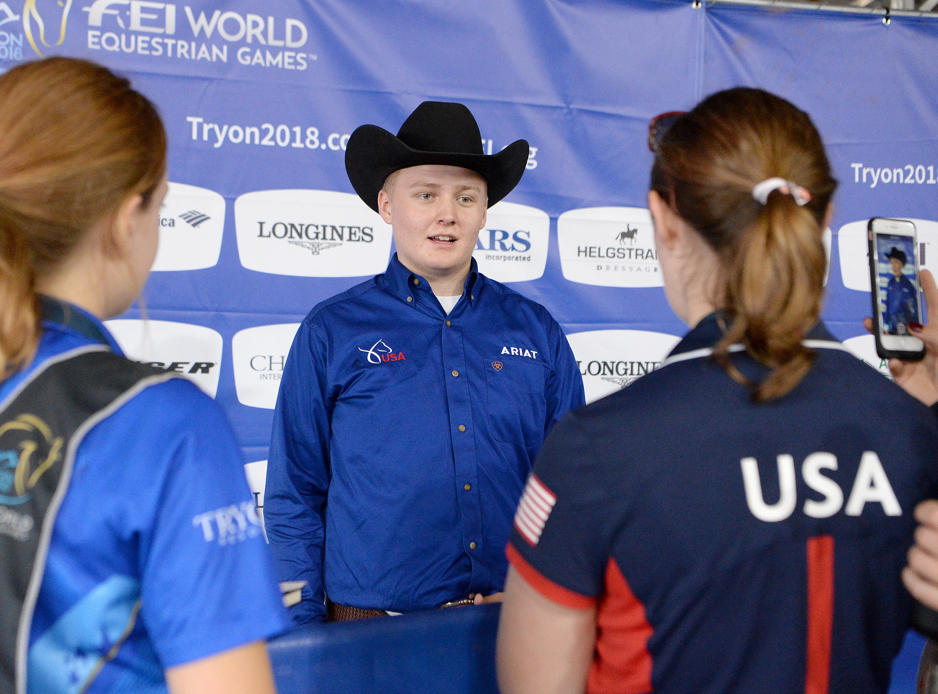Cade Mccutcheon, of Texas, talks with media members after his turn in the ring for the reining competition during the FEI World Equestrian Games at the Tryon International Equestrian Center on Sept. 12, 2018. A score of 229 put him in the lead for the morning's competition lineup. He is the youngest United States athlete in the games at 18-years-old.