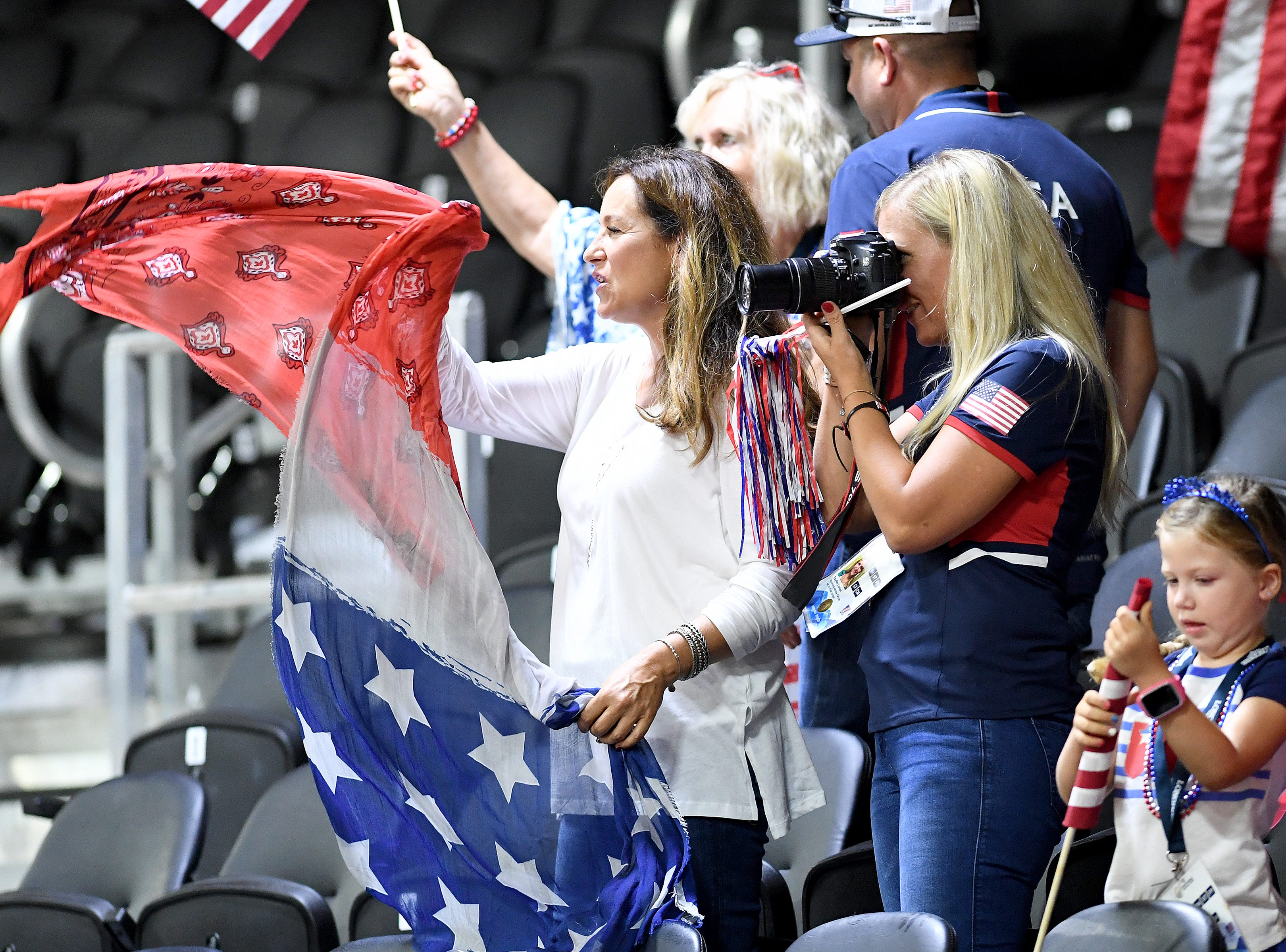 American fans cheer during the reining competition of the FEI World Equestrian Games at the Tryon International Equestrian Center on Sept. 12, 2018.