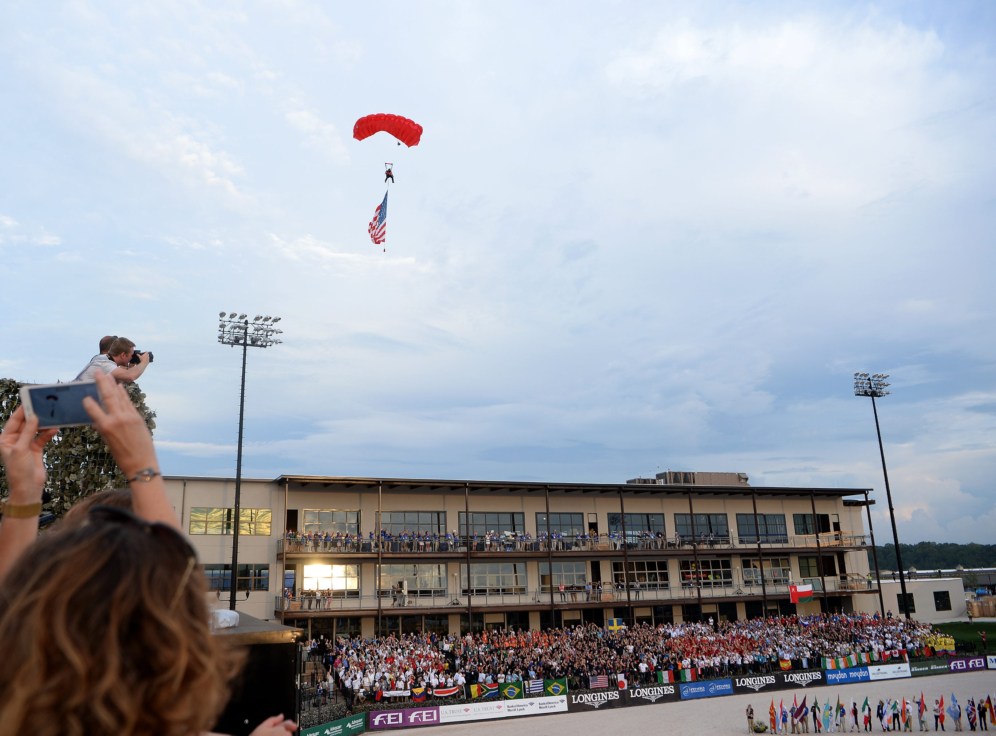 A parachuter brings in the American flag during the opening ceremony for the FEI World Equestrian Games at the Tryon International Equestrian Center on Sept. 11, 2018.