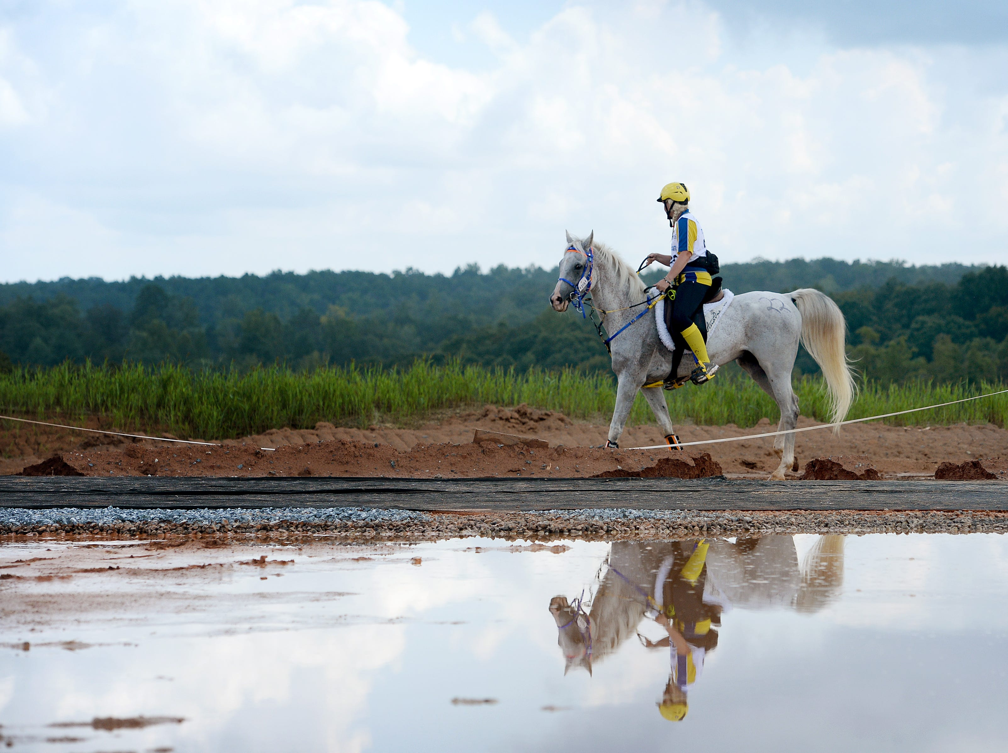 A Swedish rider, Yvonne Ekelund, sets out on her horse, Hedonizt, for another lap of the Endurance race during the FEI World Equestrian Games at the Tryon International Equestrian Center on Sept. 12, 2018.
