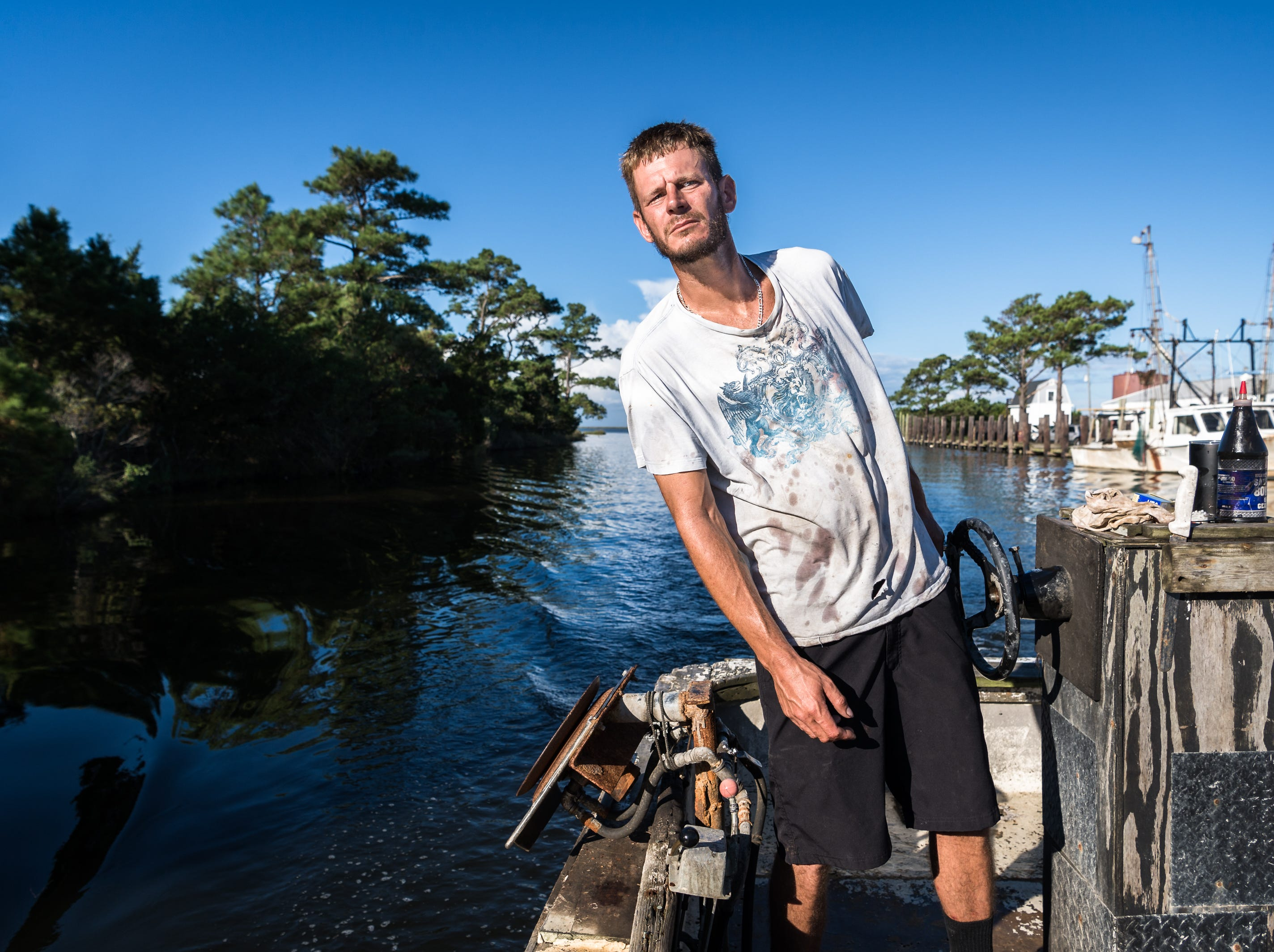 Dane Evans, a fisherman, 36, of Swan Quarter, drives his 31-year-old boat, Captain Drew, named after his six-year-old son, around the Swanquarter Bay, Sept. 12, 2018. As Hurricane Florence moves in, a storm surge of about three to six feet is expected for Swan Quarter, and around six feet for Ocracoke Island with 12-20 inches of rainfall for the entire area. Hyde county as well as several surrounding counties are under mandatory evacuation. Evans will be traveling to Washington, NC to stay with his girlfriend during the hurricane.