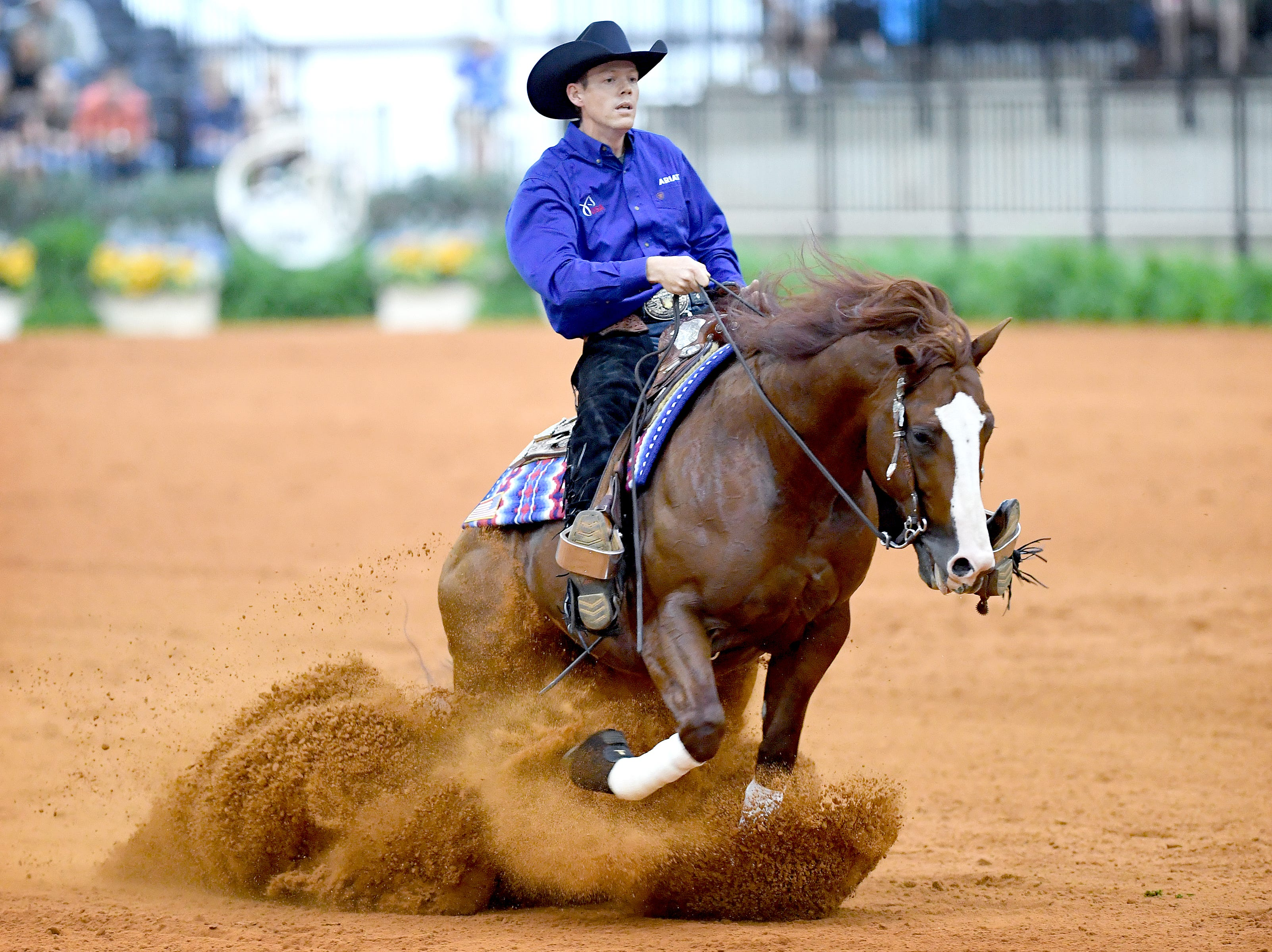 American Gabe Hutchins, on his horse, FM Shine N Tag Chex, competes in the reining competition during the FEI World Equestrian Games at the Tryon International Equestrian Center on Sept. 12, 2018.