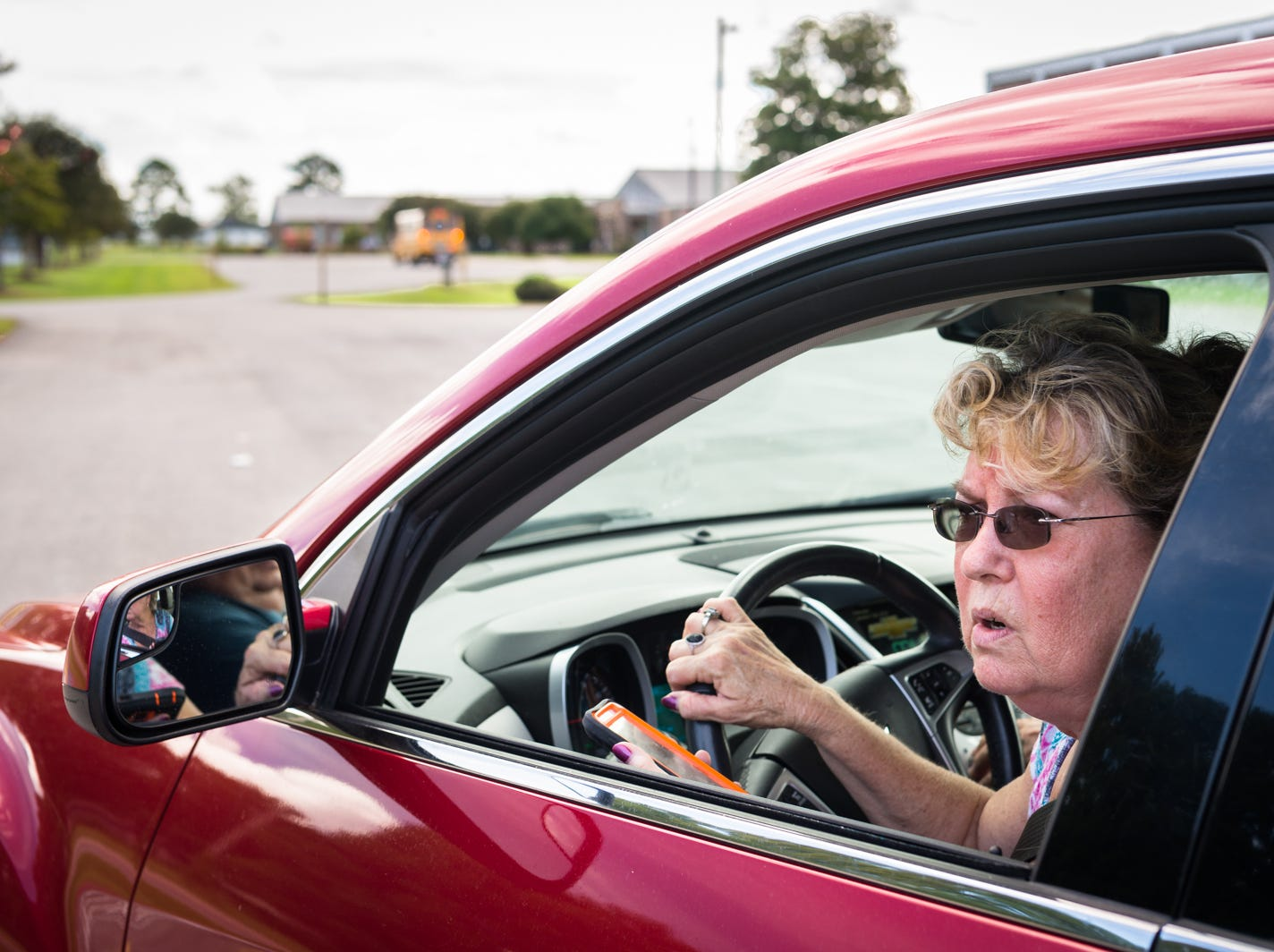 Elizabeth Gurganus, of Swan Quarter, prepares to evacuate to Tyner, outside Elizabeth City, with her husband before Hurricane Florence makes landfall, Sept. 12, 2018. A storm surge of about three to six feet is expected for Swan Quarter, and around six feet for Ocracoke Island with 12-20 inches of rainfall for the entire area. Hyde county as well as several surrounding counties are under mandatory evacuation.