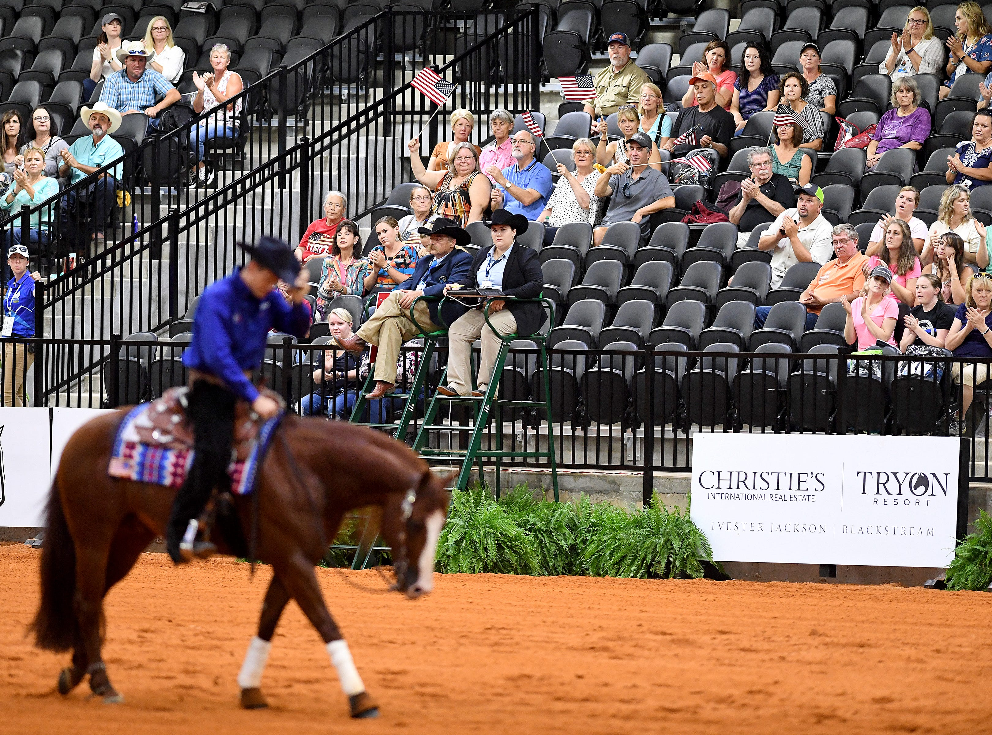 American Gabe Hutchins, on his horse, FM Shine N Tag Chex, tips his hat as the crowd cheers following the reining competition during the FEI World Equestrian Games at the Tryon International Equestrian Center on Sept. 12, 2018.