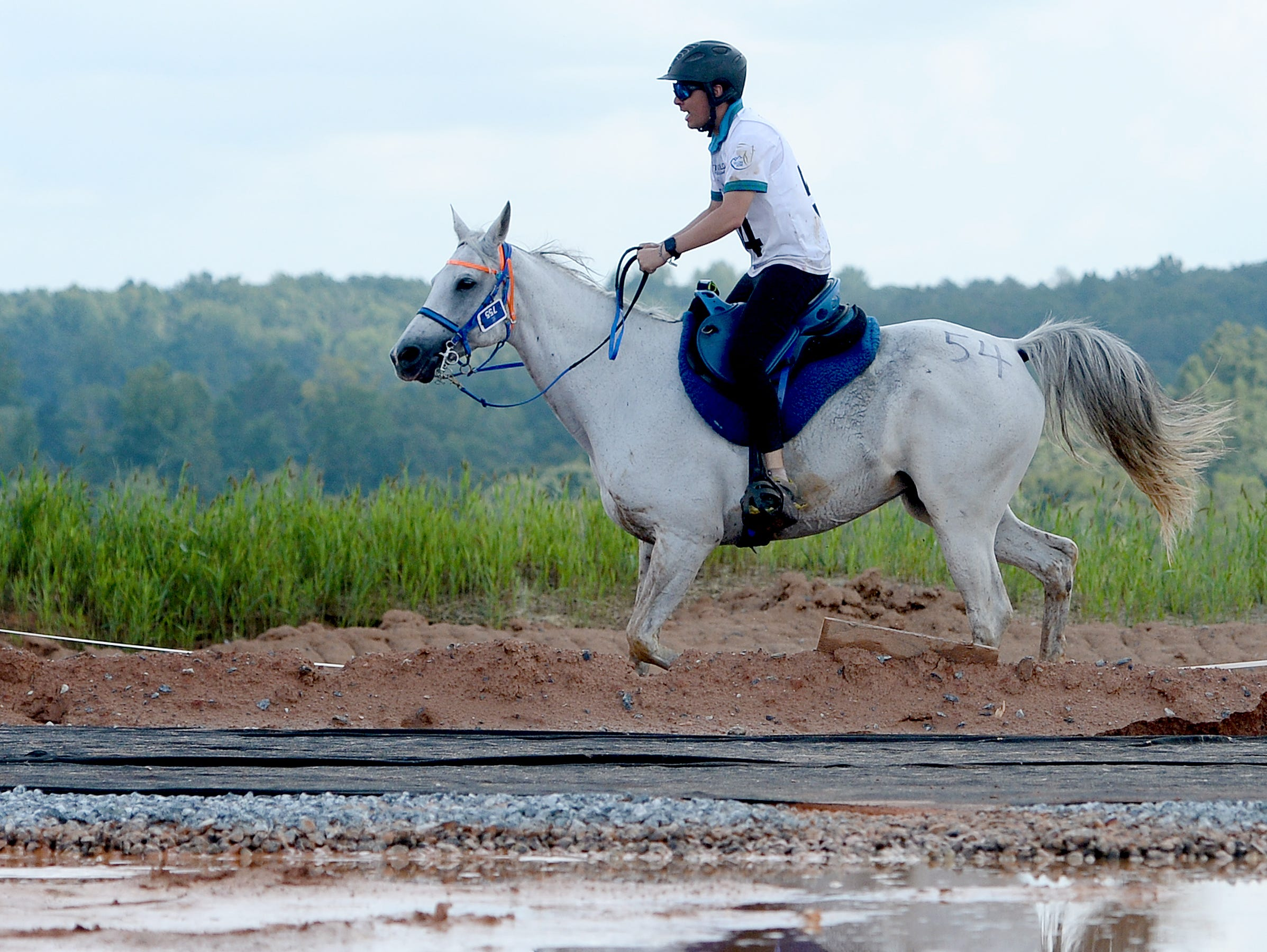 Guatemalan rider Maurico Evans, on his horse, Zara Me, sets out for another lap of the Endurance race during the FEI World Equestrian Games at the Tryon International Equestrian Center on Sept. 12, 2018.