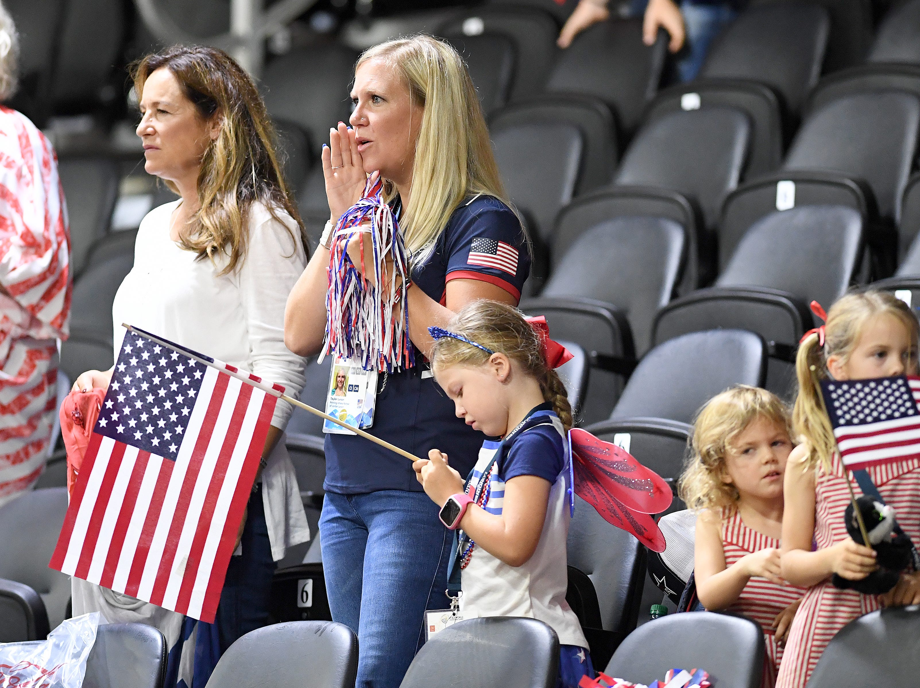 American fans cheer for Cade Mccutcheon during the reining competition of the FEI World Equestrian Games at the Tryon International Equestrian Center on Sept. 12, 2018.