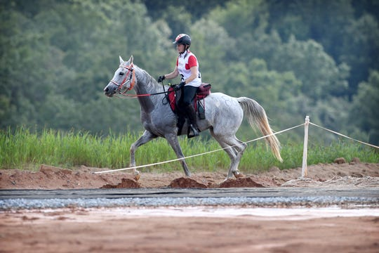 Canadian rider Kimberley Woolley, on her horse, Schakka Khan, sets out for another lap of the Endurance race during the FEI World Equestrian Games at the Tryon International Equestrian Center on Sept. 12, 2018.