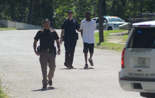 Police detained for questioning the resident of the house at 86 East Grand Circle after two men were shot.