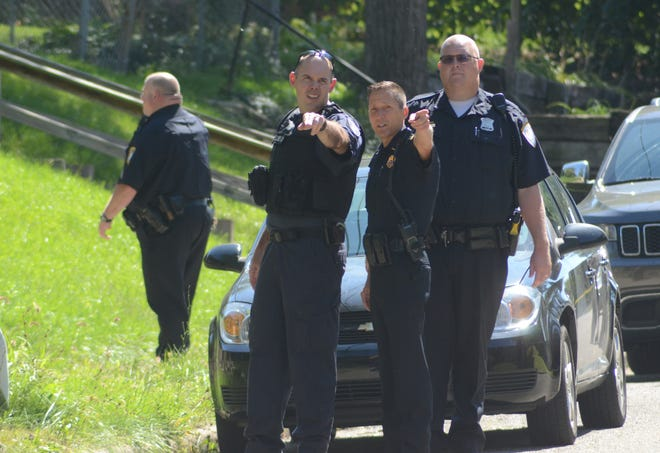 Battle Creek police begin the search on East Grand Circle for evidence at the scene of a shooting where two men were wounded Wednesday, Sept. 12, 2018.