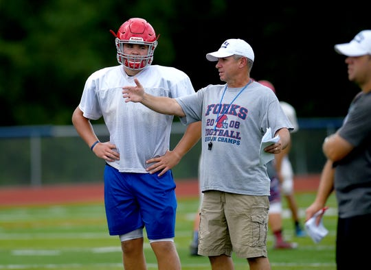 Lucas Scott, left, and Chenango Forks coach David Hogan have a discussion during a 2018 practice. Hogan said Scott exceeded his expectations last season and expects even more from him this season.