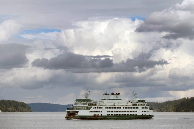 The WSF ferry Chimacum sails under the clouds off  Waterman Dock in Port Orchard on Wednesday, September 12, 2018.