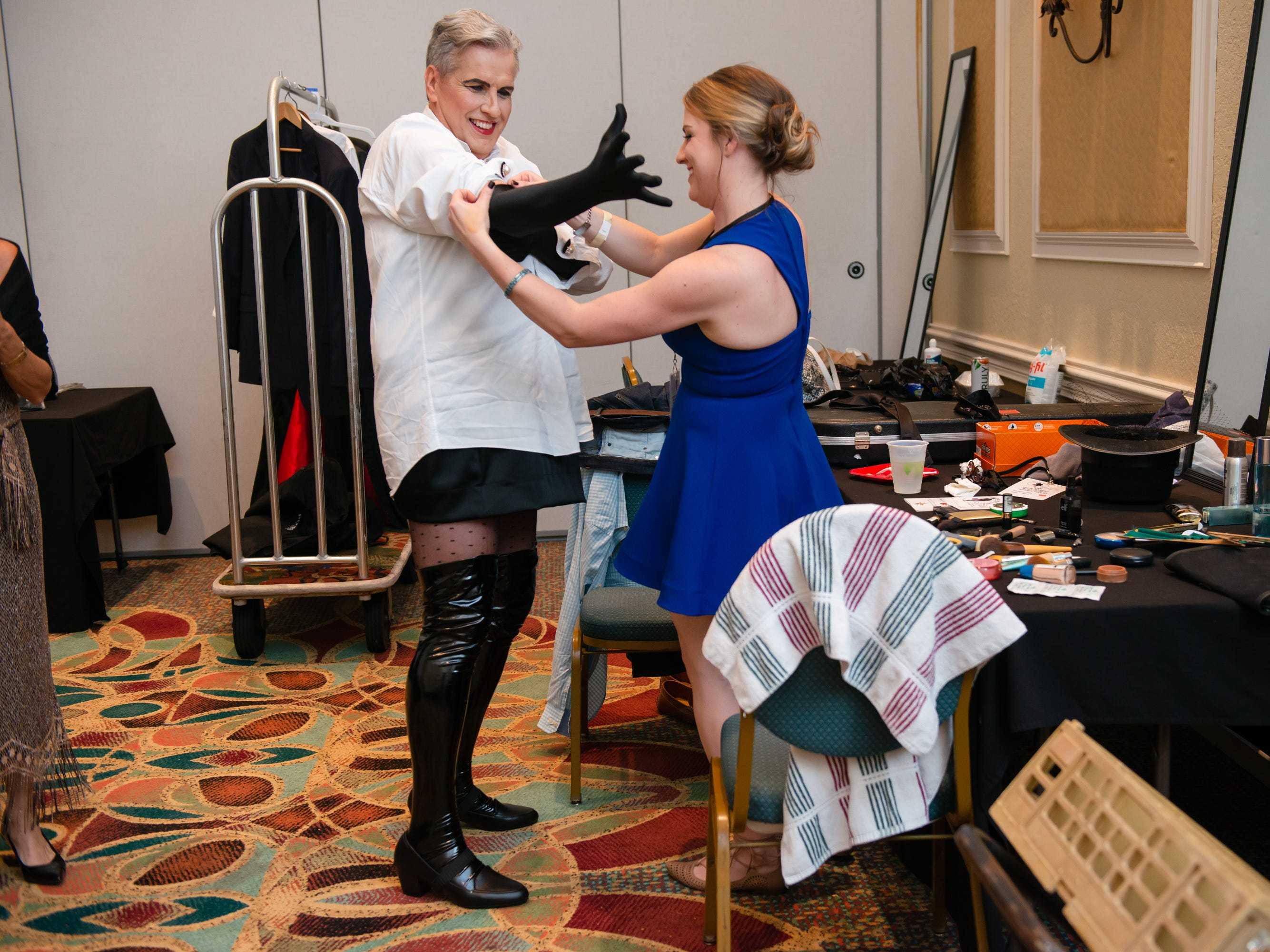 """Robert Moletteire gets dressed as Shania Twain with the assistance of Sarah Smith at """"Dude Looks Like a Lady"""" event benefitting the Women's Center."""