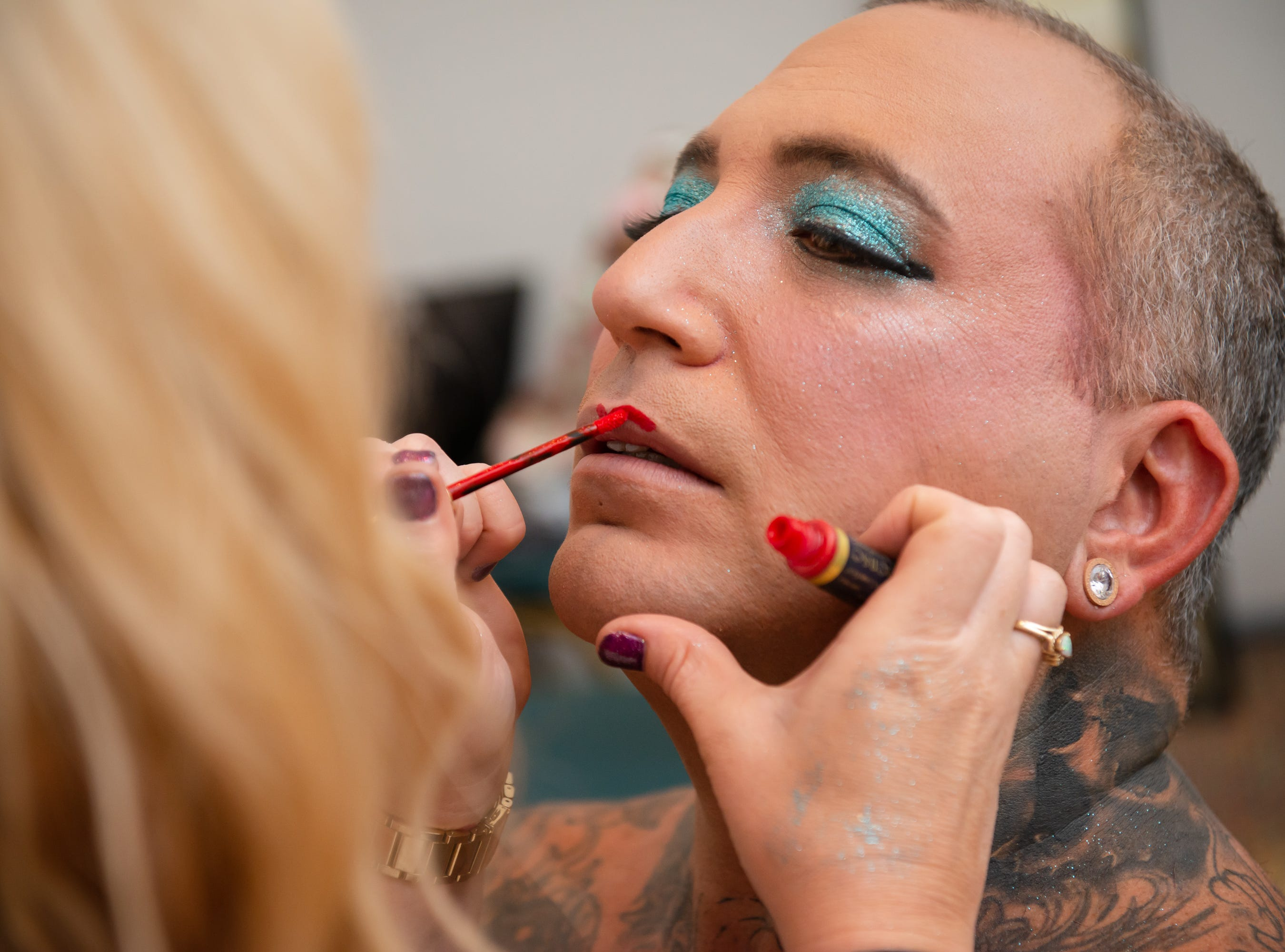 """Lisa Fountain does the makeup of Jayvo Scott at """"Dude Looks Like a Lady"""" event benefitting the Women's Center."""