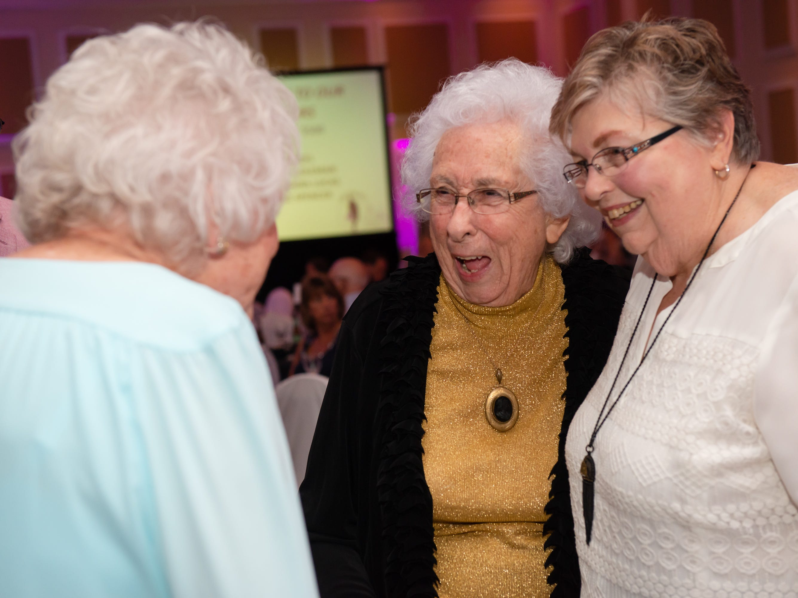 """Dr. Pat Manning visits with friends at """"Dude Looks Like a Lady"""" event benefitting the Women's Center."""