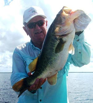 Farm 13-Stick Marsh bass fishing expert Jim Porter of Palm Bay shows off a nice 6-pound bass he caught and released while casting over mussel beds along sunken canal banks in the famous impoundment near Fellsmere. It's a summertime technique Porter has used for years.
