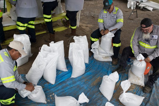 Corpus Christi city employees fill up sandbags  to give away to residents on Wednesday, Sep. 12, 2018  at the J.C. Elliott Collection Center.
