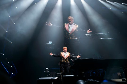 Elton John stands before a sold out crowd following a performance of 'Bennie and the Jets' during his 'Farewell Yellow Brick Road' tour Tuesday, Sept. 11, 2018 at the Wells Fargo Center in Philadelphia, Pa.