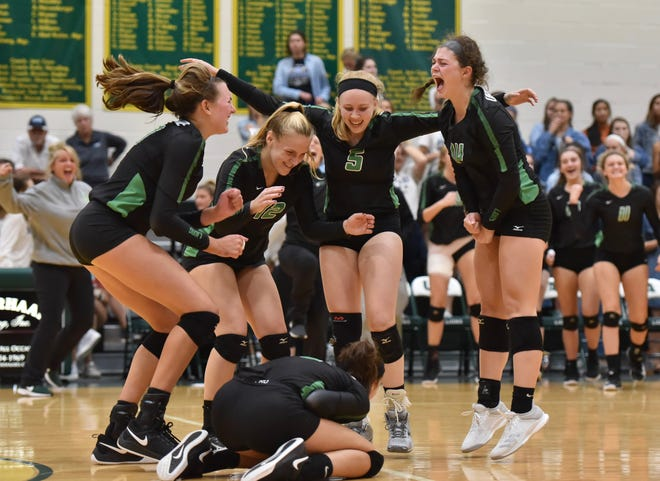 The Ursuline Lions celebrate after winning the match against Mount Notre Dame.  The Lions won 3 straight sets, after falling down 0-2 to Mount Notre Dame  Tuesday, Sept. 11, 2018 at Ursuline Academy