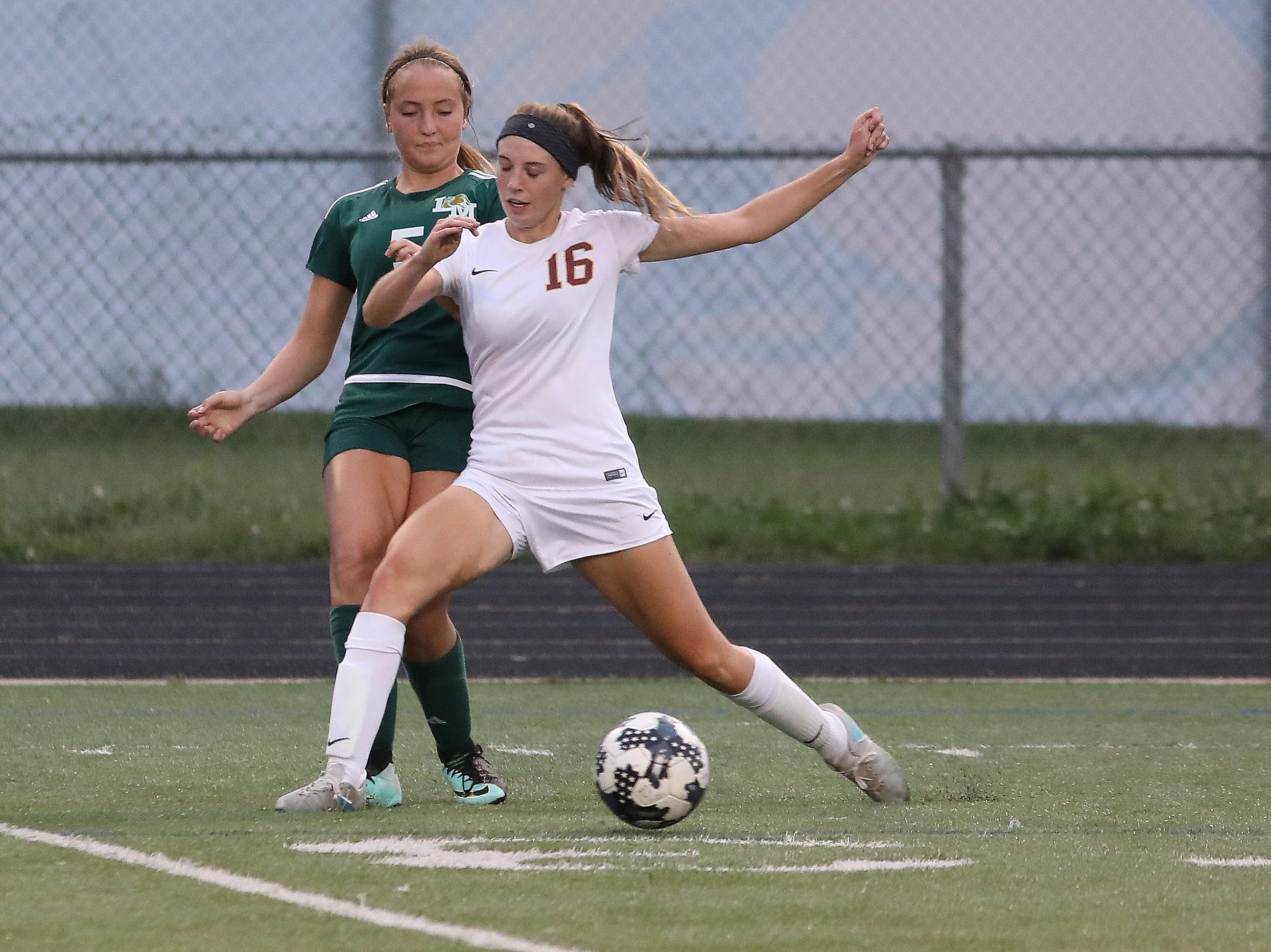 Little Miami's  Kelly Sizemore (5) and Ross's Allison Becker compete for the ball during their soccer game, Tuesday, Sept. 11, 2018.