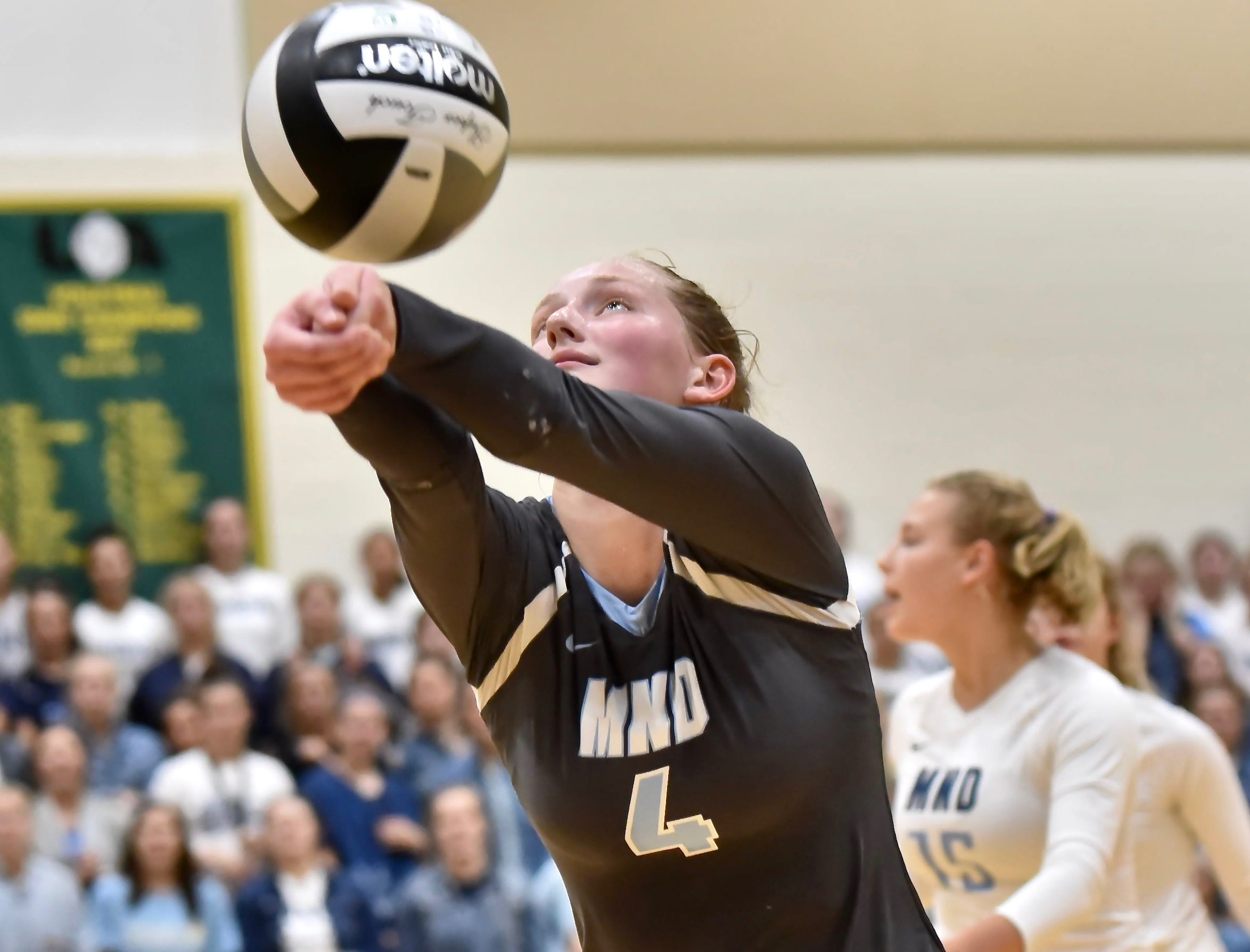 Mount Notre Dame's Emily Ernst saves a ball against Ursuline Tuesday, Sept. 11, 2018 at Ursuline Academy