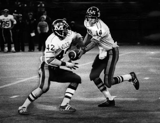 Taken Nov. 17, 1976, Tim Koegel hands off to running back Steve Givens, both part of the 1975 state championship team.