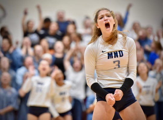 Mount Notre Dame's Sam Wolf celebrates after scoring in the first set against Ursuline Tuesday, Sept. 11, 2018 at Ursuline Academy