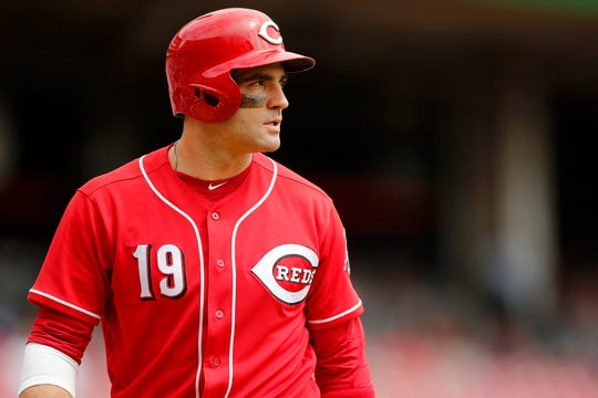 Cincinnati Reds first baseman Joey Votto (19) walks back toward the dugout after striking out in the third inning of the MLB National League game between the Cincinnati Reds and the Los Angeles Dodgers at Great American Ball Park in downtown Cincinnati on Wednesday, Sept. 12, 2018.