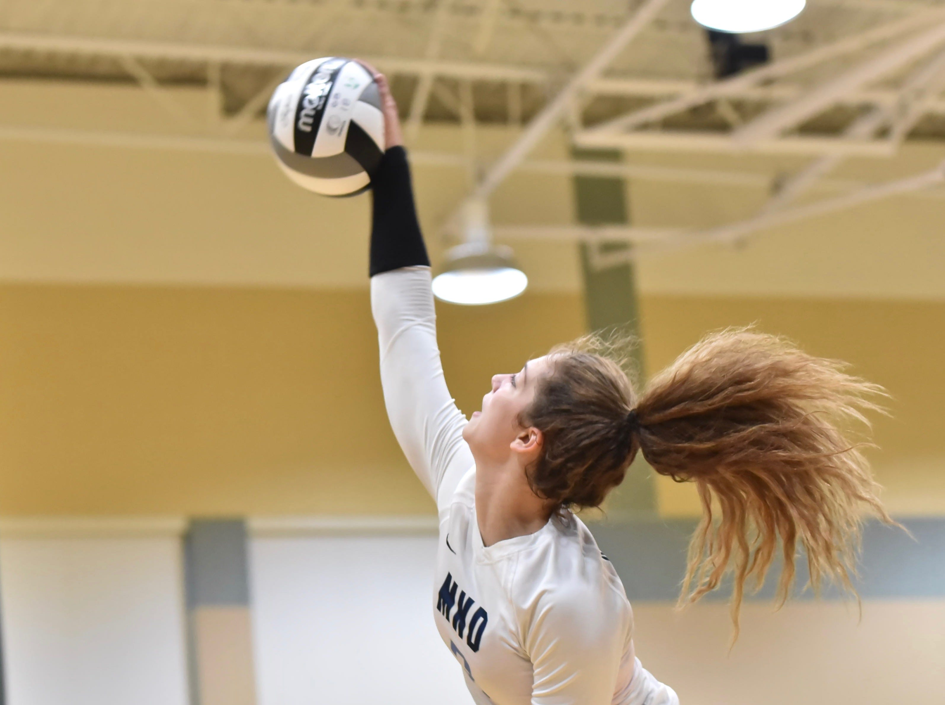 Mount Notre Dame's Sam Wolf spikes the ball against Ursuline Tuesday, Sept. 11, 2018 at Ursuline Academy