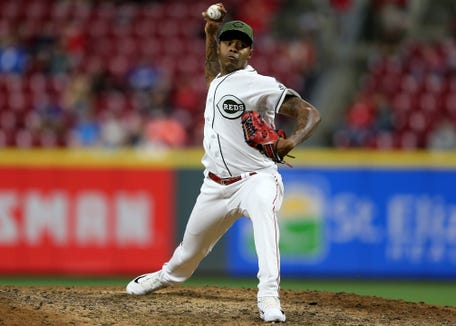 Cincinnati Reds relief pitcher Raisel Iglesias (26) delivers in the ninth inning during a baseball game between the Los Angeles Dodgers and the Cincinnati Reds, Tuesday, Sept. 11, 2018, at Great American Ball Park in Cincinnati.
