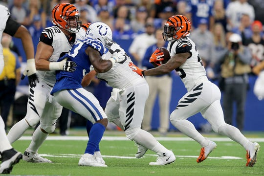 Cincinnati Bengals running back Joe Mixon (28), right, carries the ball as Cincinnati Bengals offensive guard Alex Redmond (62), left, blocks, in the third quarter during the Week 1 NFL game between the Cincinnati Bengals and the Indianapolis Colts, Sunday, Sept. 9, 2018, at Lucas Oil Stadium in Indianapolis. Cincinnati won 34-23.
