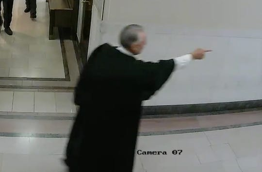 Magistrate Michael Bachman points at Kassandra Jackson as she walks away from his courtroom.