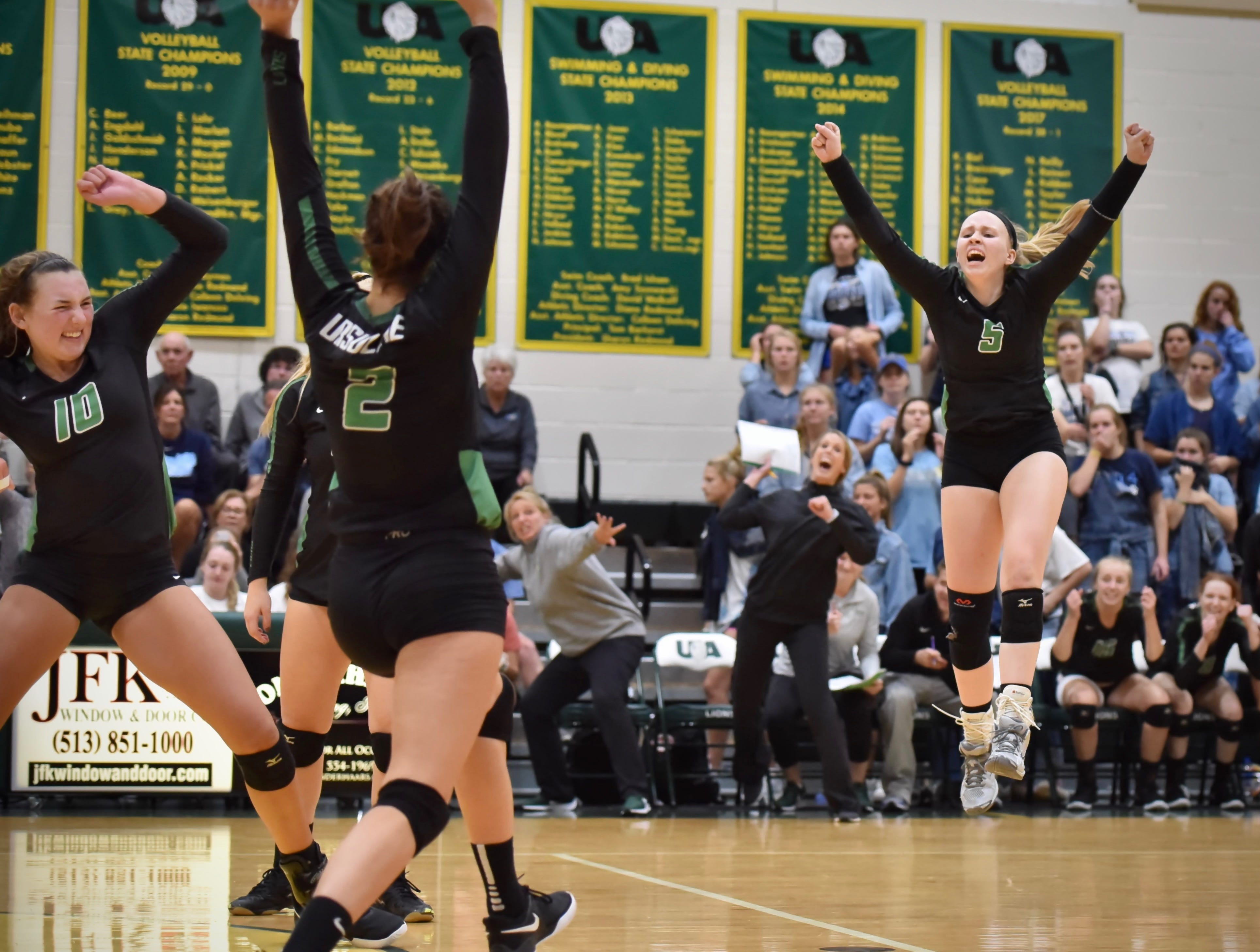 The Ursuline Lions celebrate after winning the match against Mount Notre Dame Tuesday, Sept. 11, 2018 at Ursuline Academy