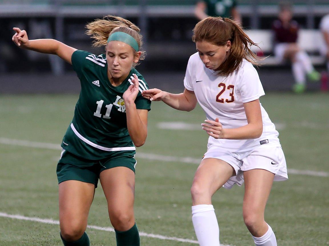 Ross's Emily Hollstegge (23) battles Little Miami's   Emma Daniels for the ball during their soccer game, Tuesday, Sept. 11, 2018.