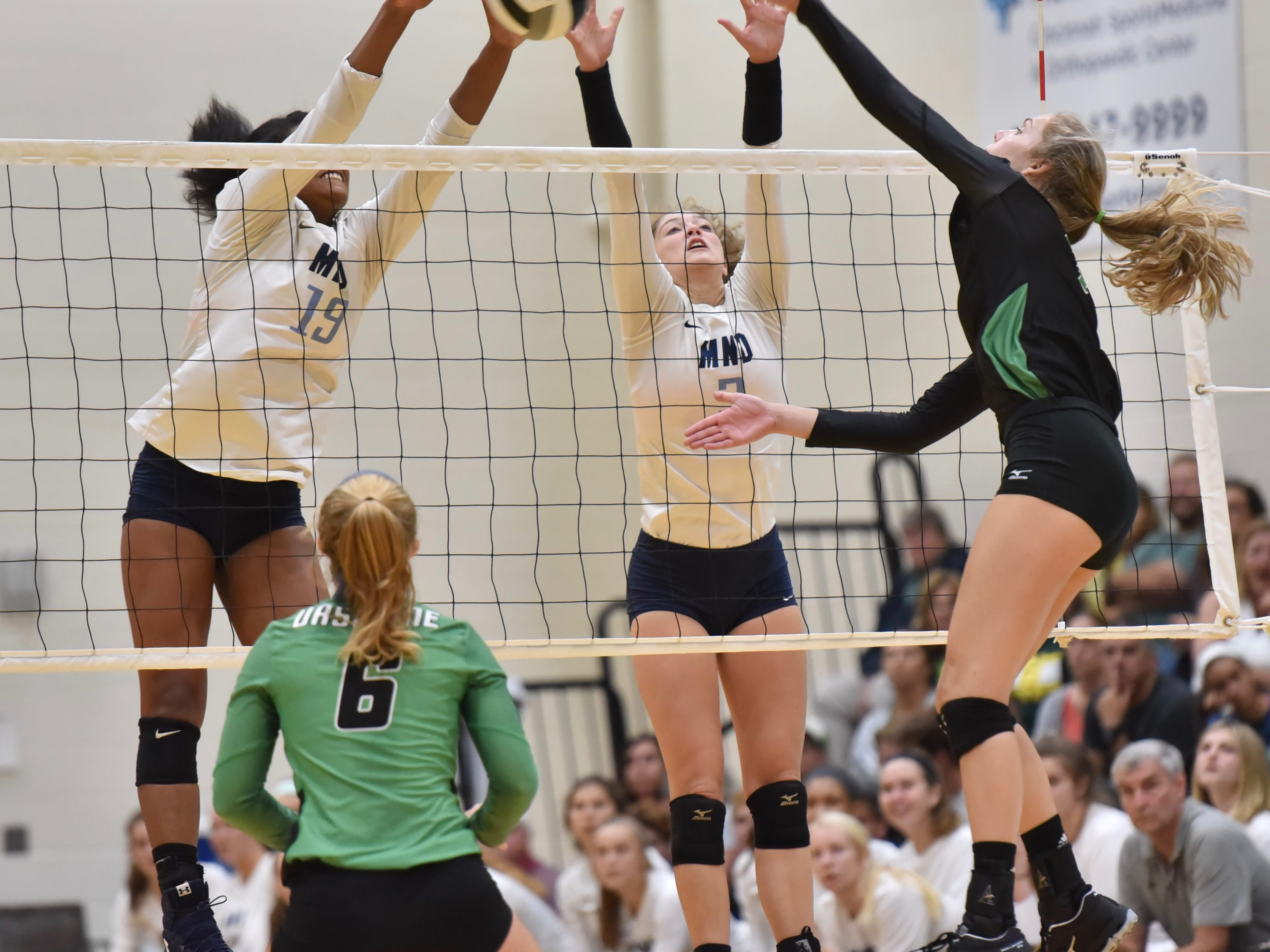 Mount Notre Dame's Ramei Jackson and Sam Wolf block an Ursuline shot Tuesday, Sept. 11, 2018 at Ursuline Academy