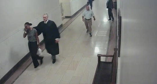 Magistrate Michael Bachman led Kassandra Jackson back to his courtroom after chasing her down in the hallway.