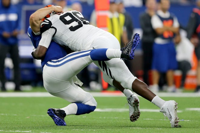 Cincinnati Bengals defensive end Carlos Dunlap (96) is penalized for a sack on Indianapolis Colts quarterback Andrew Luck (12) in the third quarter during the Week 1 NFL game between the Cincinnati Bengals and the Indianapolis Colts, Sunday, Sept. 9, 2018, at Lucas Oil Stadium in Indianapolis. Cincinnati won 34-23.