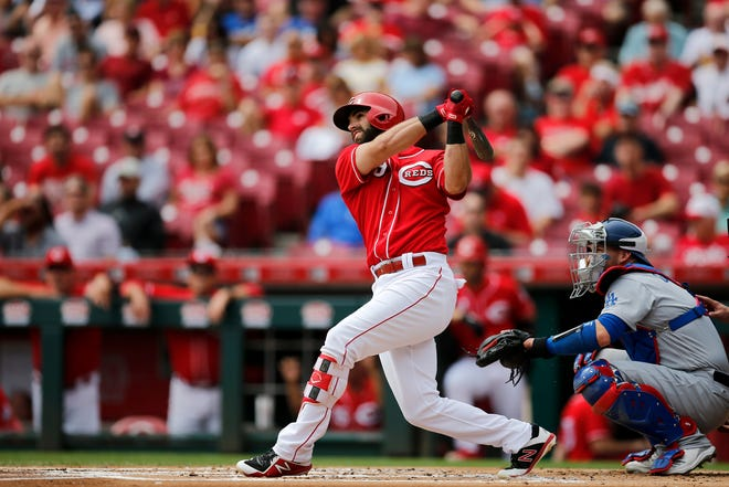 Cincinnati Reds second baseman Jose Peraza (9) follows through on a solo home run in the bottom of the first inning on Wednesday, Sept. 12, 2018.