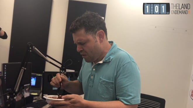ESPN Cleveland radio host Aaron Goldhammer makes a face Friday before eating horse poop after making a promise to eat it if the Cleveland Browns drafted Baker Mayfield last April.