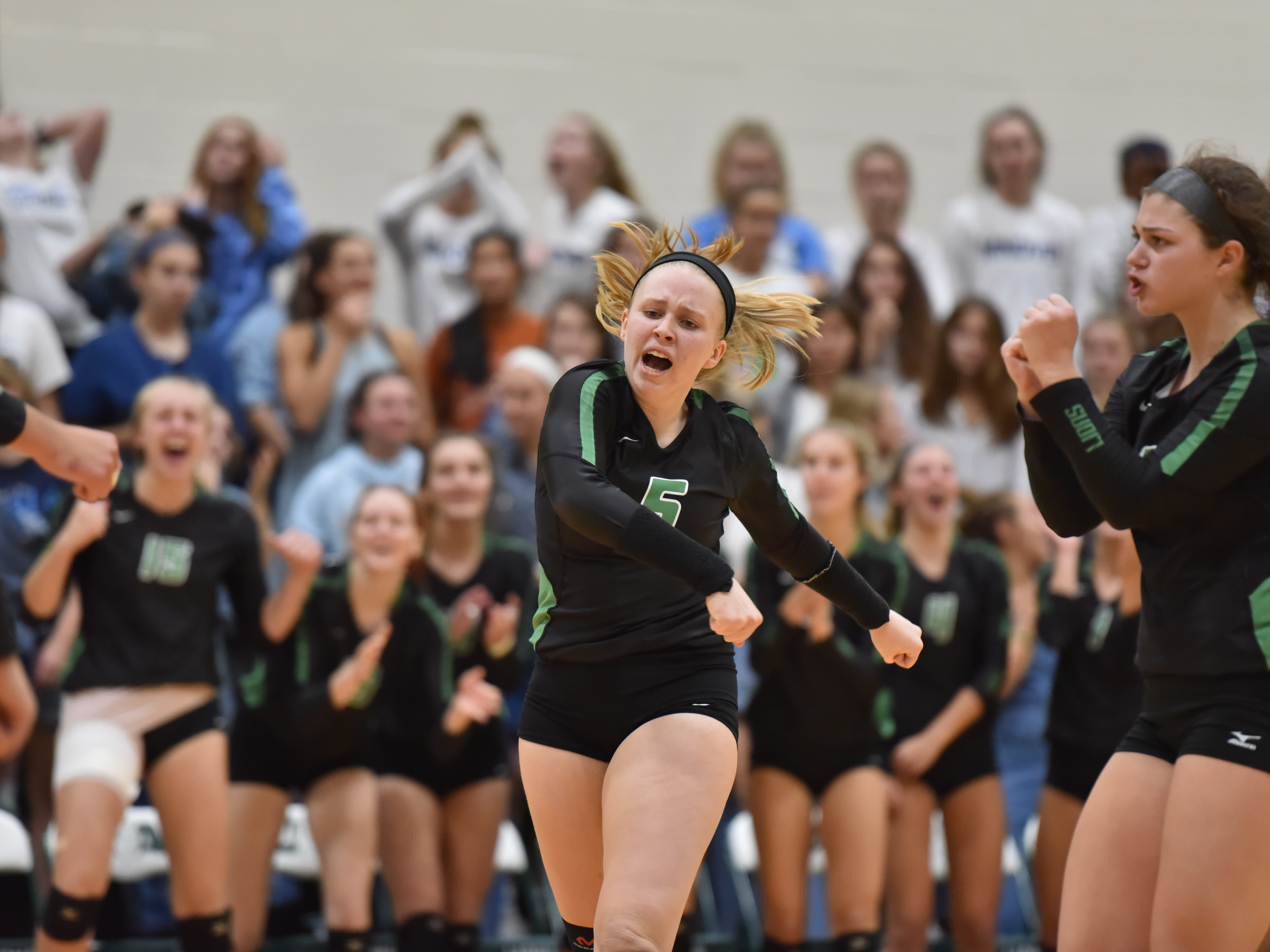 Ursuline's Katherine Meyer celebrates late in the fifth set against Mount Notre Dame Tuesday, Sept. 11, 2018 at Ursuline Academy